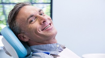 Smiling in dental chair