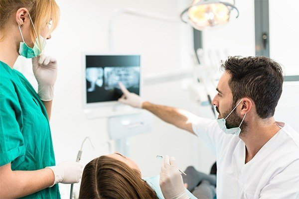 dentist pointing to an xray