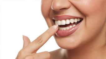 woman pointing at tooth