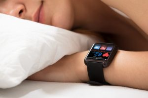 woman sleeping heart smart watch