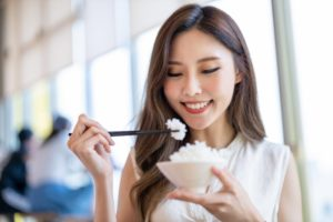 woman enjoying rice after teeth whitening in Bonita Springs