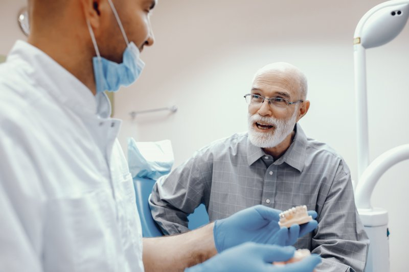 man learning about transition from dentures to dental implants